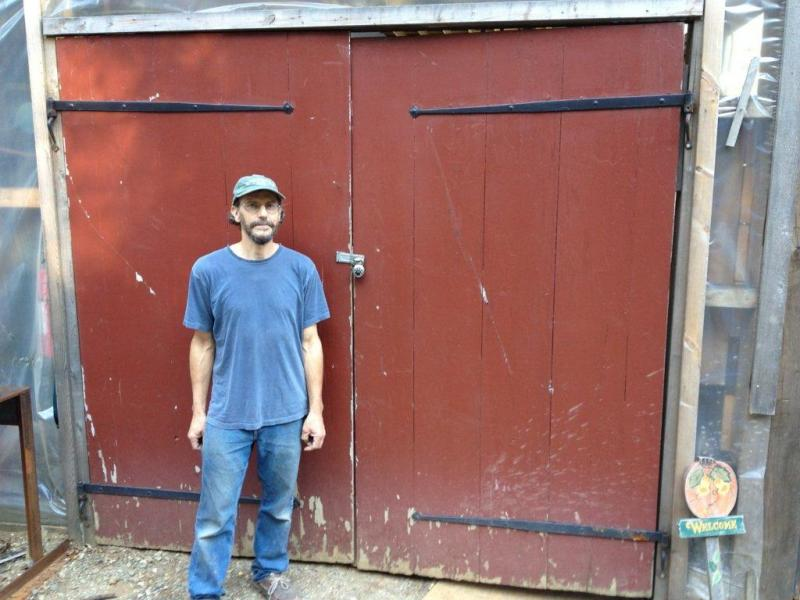 Local boat builder David Stimson stands in front of his padlocked barn on the River Road. RYAN LEIGHTON/Boothbay Register