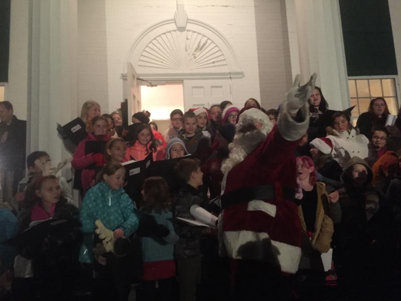 Families enjoy reindeer, Santa during Brooklyn holiday parade