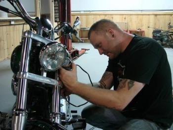 Darron Pierce changes a part on a customer's bike at the new Route 1 business, Twisted Iron Customs. SUSAN JOHNS/Wiscasset Newspaper
