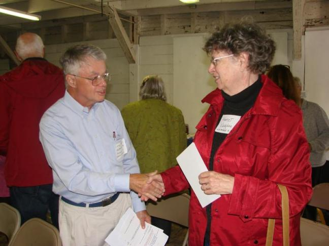 Larry Hayter, left, of the Old Bristol Historical Society, meets Harriet Vaughan of the Whitefield Historical Society, in the Nickels-Sortwell Barn in Wiscasset on September 22. SUSAN JOHNS/Wiscasset Newspaper