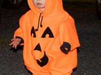 This little pumpkin enjoys the Woolwich Haunted House. Courtesy of www.woolwich.us